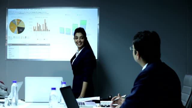 businesswoman giving presentation in the office, delhi, india - board room stock videos & royalty-free footage