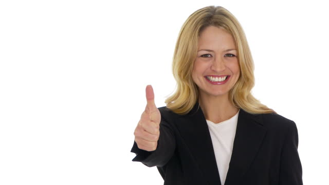 Businesswoman giving thumbs up to camera