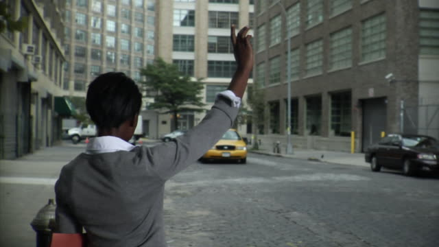 WS R/F Businesswoman hailing taxi, then getting in and leaving, Tribeca, New York, USA