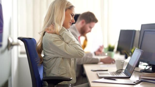 businesswoman has a neck pain - neckache stock videos & royalty-free footage