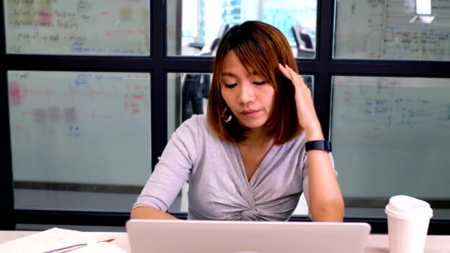 businesswoman having a bad headache . office syndrome - chronic illness stock videos and b-roll footage