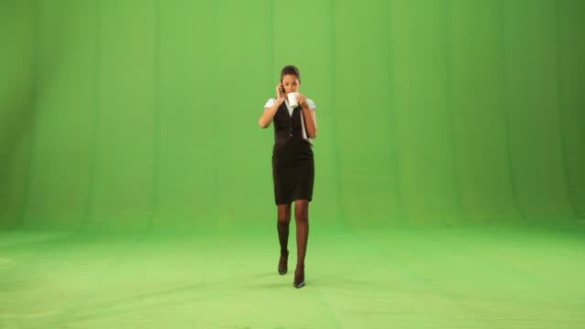 businesswoman having a cup of tea and talking on a mobile phone  - chroma key studio stock videos & royalty-free footage