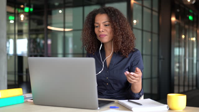 businesswoman having a video call in the office - explaining stock videos & royalty-free footage