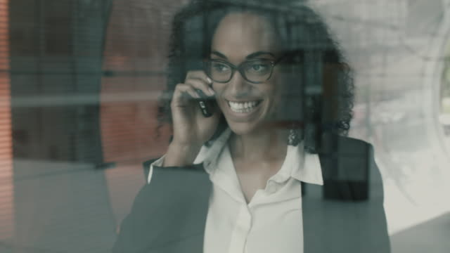 businesswoman having friendly conversation on mobile phone - assertiveness stock videos & royalty-free footage