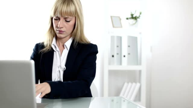 hd: businesswoman having headache - head massage stock videos and b-roll footage