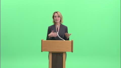 ms, businesswoman having speech at podium in studio - public speaker stock videos & royalty-free footage