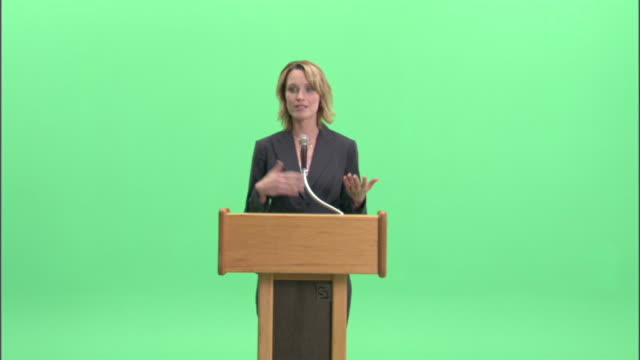 ms, businesswoman having speech at podium in studio - blonde hair stock videos & royalty-free footage