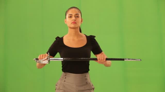 Businesswoman holding a sword