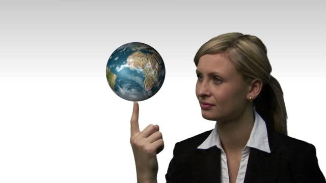 CU, COMPOSITE, Businesswoman holding rotating globe