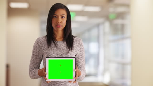 Businesswoman holding tablet with blank screen for custom content