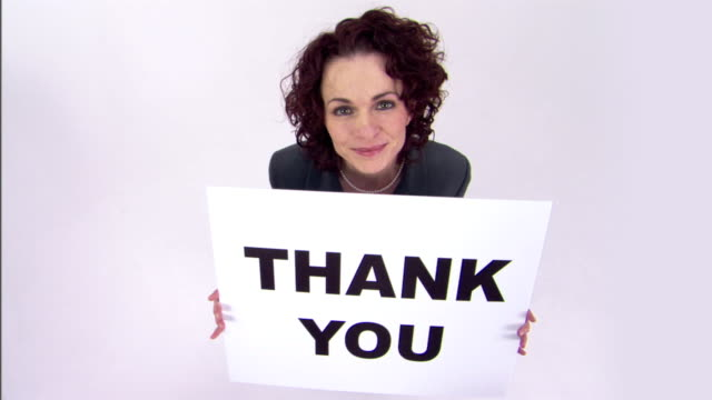 businesswoman holding thank you sign - thank you phrase stock videos and b-roll footage