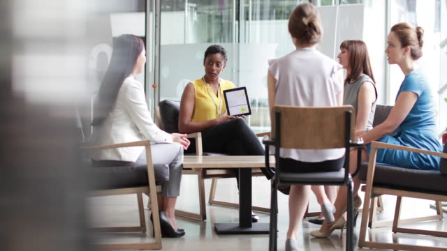 businesswoman in a meeting using a digital tablet - human age stock videos and b-roll footage