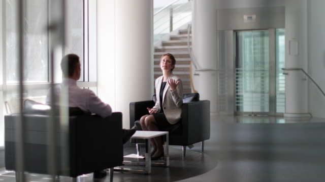 businesswoman in a meeting - business person stock videos & royalty-free footage