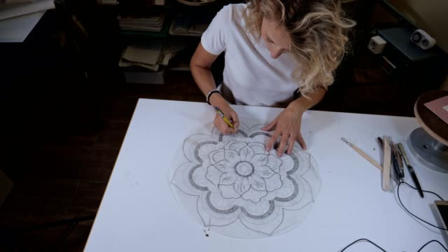 businesswoman in action, a craftswoman creating handmade coloured tiles, the whole process, part of series - drawing art product stock videos & royalty-free footage