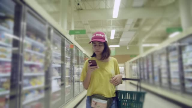 businesswoman in grocery store - list stock videos & royalty-free footage