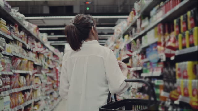 Businesswoman in Grocery Store
