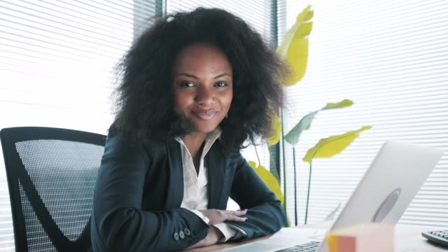 businesswoman in her office looking at camera. - beautiful people stock videos & royalty-free footage