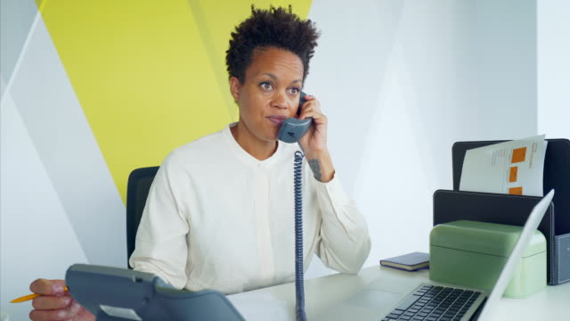 businesswoman in her office. - using phone stock videos & royalty-free footage