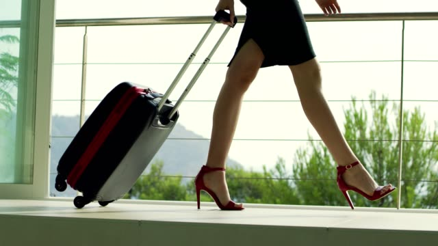 businesswoman in red highheels arriving to airport. - dress shoe stock videos & royalty-free footage