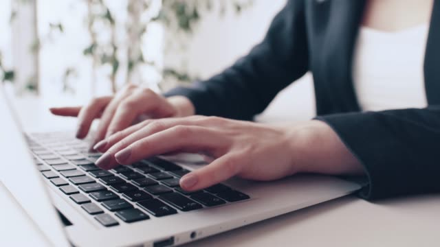 businesswoman is typing on a computer in the office - enter key stock videos & royalty-free footage
