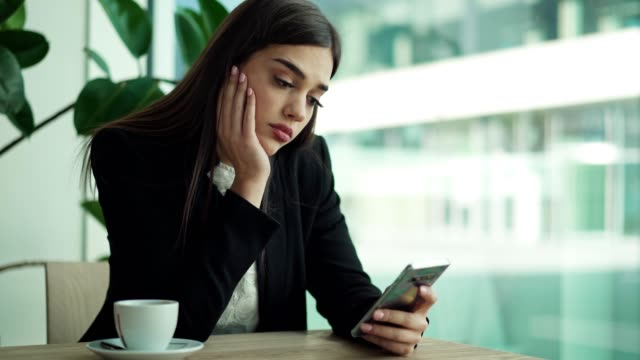 businesswoman is using cellphone in restaurant - distracted stock videos & royalty-free footage
