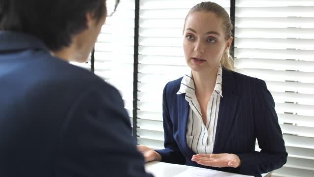 businesswoman job interview on businessman - recruitment stock videos & royalty-free footage