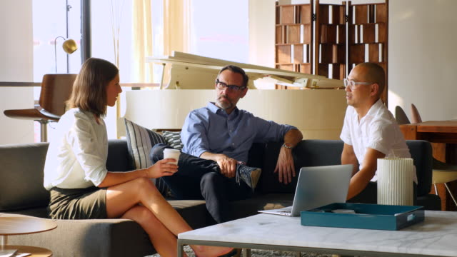 ms businesswoman leading discussion with colleagues during informal office meeting - colleague stock videos & royalty-free footage