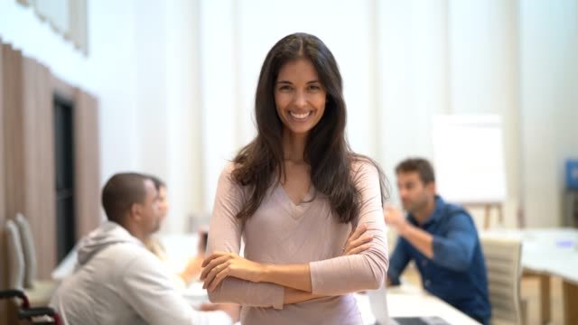 businesswoman leading her team at board room - variation stock videos & royalty-free footage