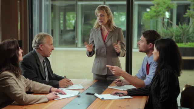 ms businesswoman leading meeting / portland, oregon, usa - arms raised stock videos & royalty-free footage