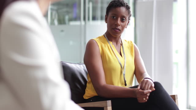 businesswoman listening in a meeting - armchair stock videos & royalty-free footage