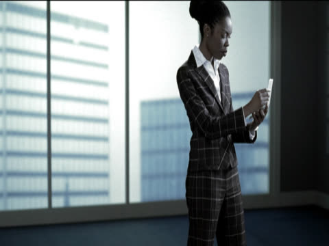 businesswoman looking at a hand held pc and checking the time - electronic organiser stock videos & royalty-free footage
