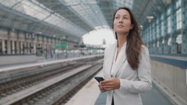 businesswoman looking at mobile phone - formal stock videos & royalty-free footage