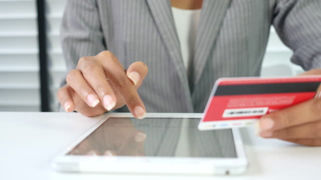 businesswoman making an online credit card purchase