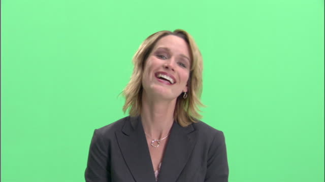 CU, Businesswoman making faces in studio