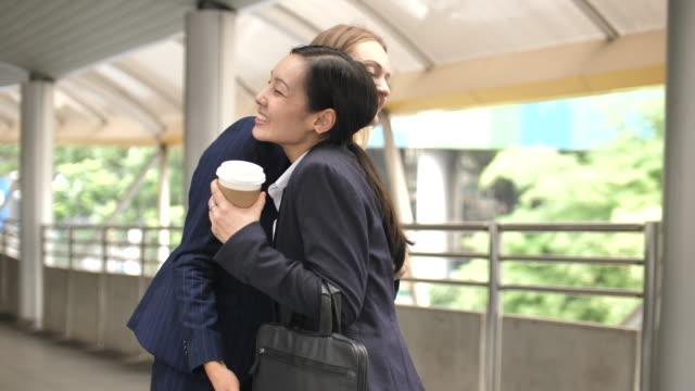 businesswoman meet her best friend - colleague hug stock videos & royalty-free footage
