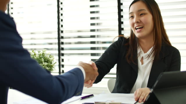 Businesswoman meeting a job interview in the office and Handshake