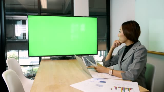 businesswoman meeting on video conferencing with green screen - television chroma key stock videos & royalty-free footage