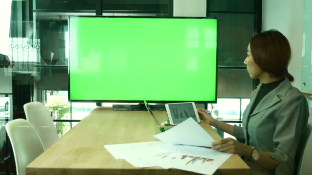 Businesswoman Meeting with Video conference on TV Monitor green screen