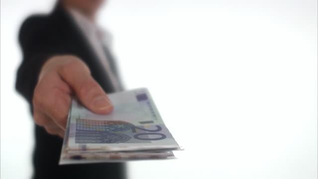stockvideo's en b-roll-footage met businesswoman offering  euro bills sweden. - omkoping
