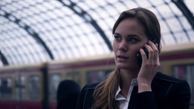 Businesswoman on phone at station