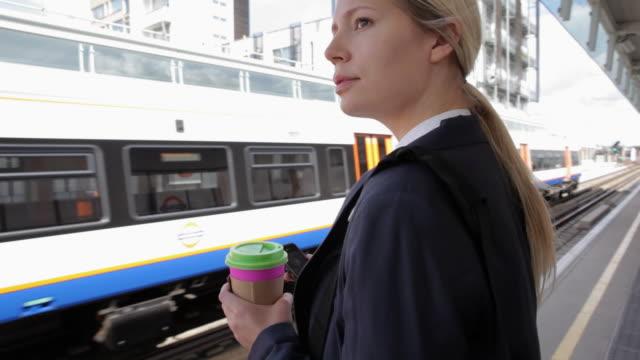 businesswoman on platform waiting for train - archivista video stock e b–roll