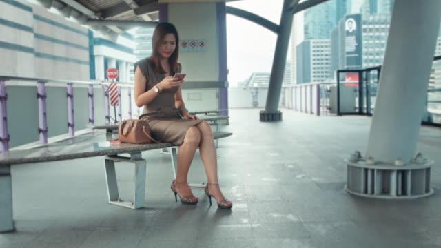 Businesswoman on railroad station