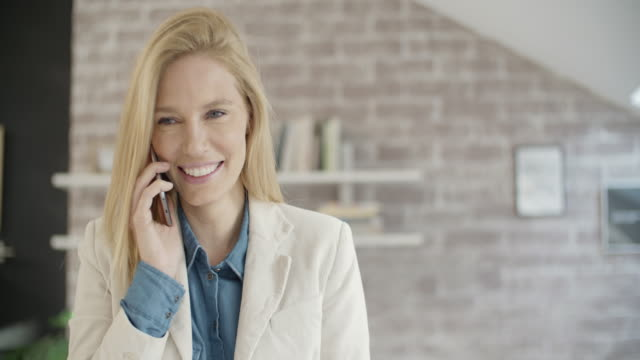 businesswoman on the phone indoors. - mid adult stock videos & royalty-free footage