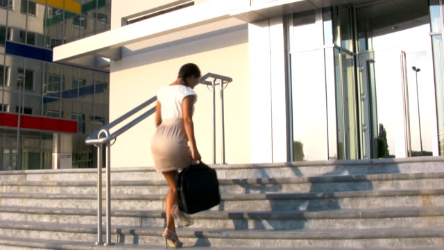 businesswoman on the stairs - laptop bag stock videos and b-roll footage