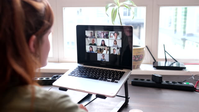 businesswoman on video call with colleagues - video conference stock videos & royalty-free footage