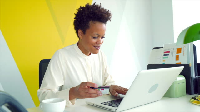 Businesswoman paying online.