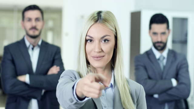 businesswoman pointing on you - pointing stock videos and b-roll footage