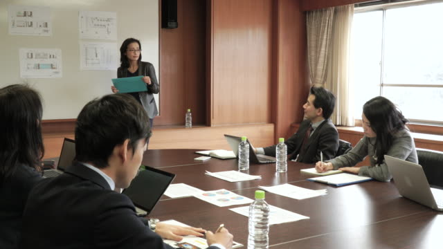 businesswoman presenting in meeting room - only japanese stock videos & royalty-free footage