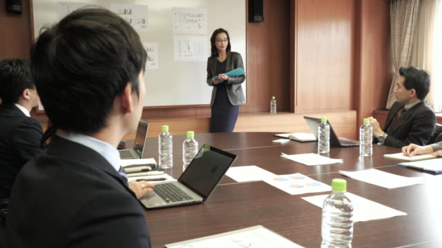 businesswoman presenting in meeting room - staff meeting stock videos & royalty-free footage