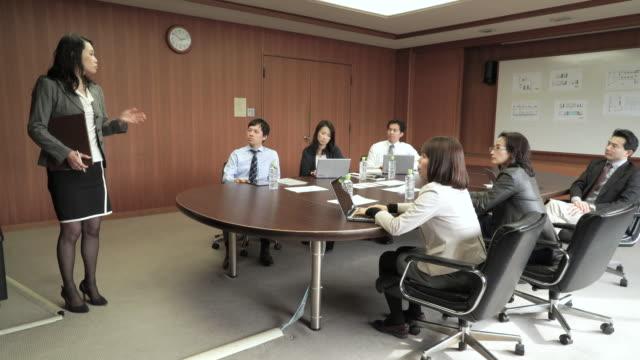businesswoman presenting in meeting room - staff meeting stock videos and b-roll footage